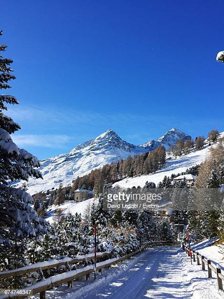 Scenic View Of Swiss Alps Against Clear Blue Sky During Winter