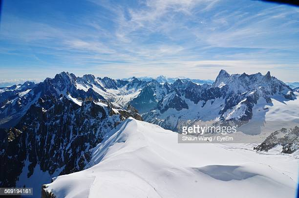 scenic view of swiss alps covered with snow against sky - european alps stock photos and pictures