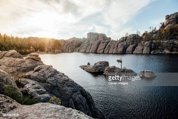 scenic view of sylvan lake and rock formation against sky at custer state park - black hills stock photos and pictures