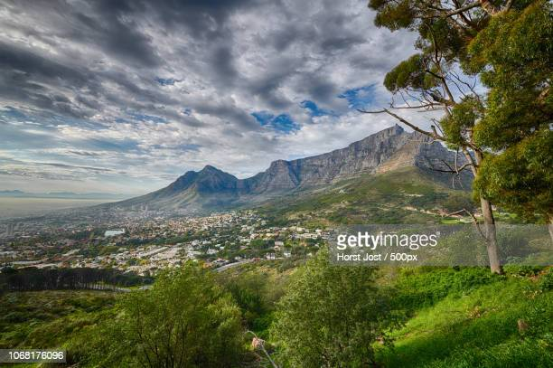 scenic view of table mountain with city below - table mountain stock pictures, royalty-free photos & images