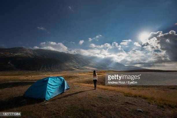 scenic view of tent on field against sky, campo imperatore - andrea rizzi stock pictures, royalty-free photos & images