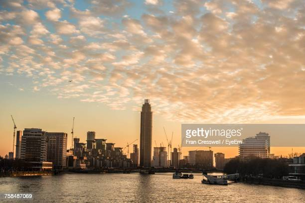Scenic View Of Thames River By Vauxhall Tower Against Sky During Sunset