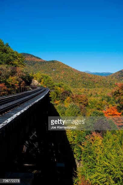 scenic view of the white mountains with railroad in fall colors - crawford notch stock pictures, royalty-free photos & images