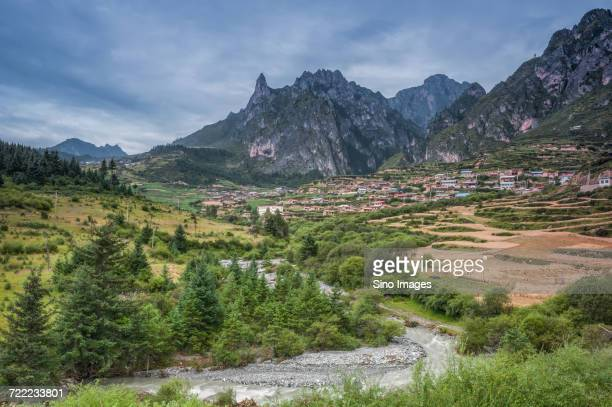 scenic view of tibetan village in the mountains near river, gannan, gansu, china - gansu province stock pictures, royalty-free photos & images
