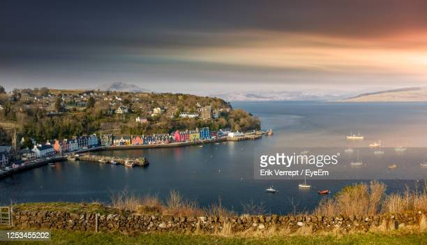 scenic view of tobermory bay against dramatic sky during sunset - scotland stock pictures, royalty-free photos & images