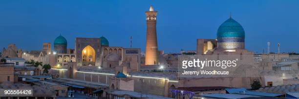 scenic view of towers and domes in city at night - uzbekistan foto e immagini stock
