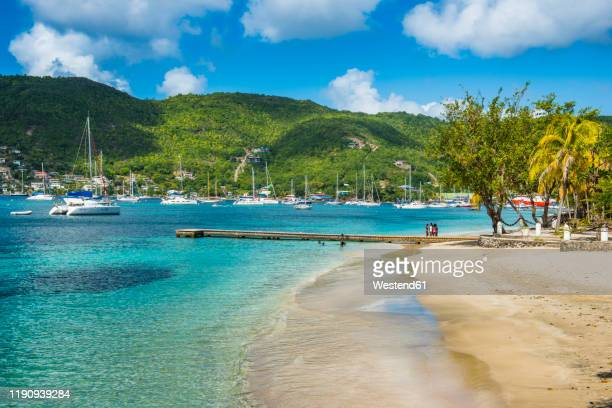 scenic view of town beach at port elizabeth, admiralty bay, bequia, st. vincent and the grenadines, caribbean - saint vincent and the grenadines stock pictures, royalty-free photos & images