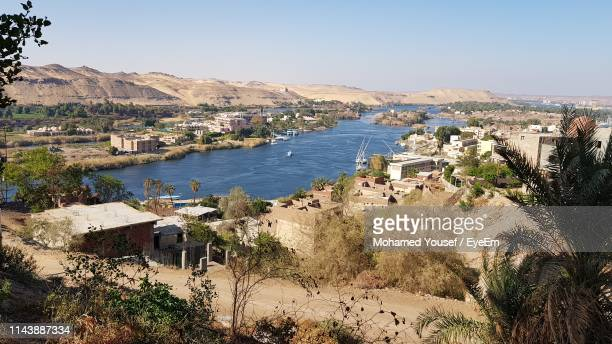 scenic view of town by buildings against sky - aswan stock pictures, royalty-free photos & images