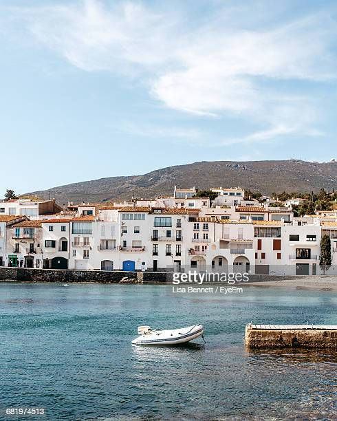 scenic view of town by harbor - cadaques stock pictures, royalty-free photos & images