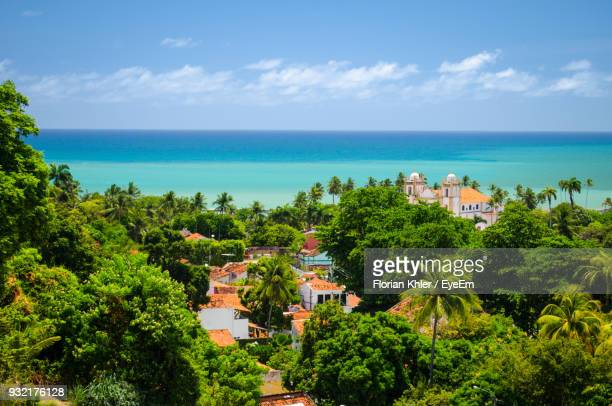 scenic view of town by sea against sky - recife stock pictures, royalty-free photos & images