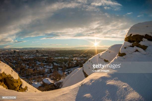 Scenic view of townscape against cloudy sky during winter
