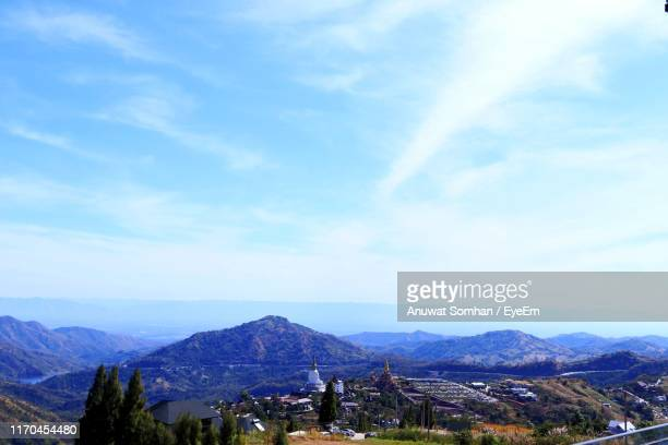 scenic view of townscape against sky - anuwat somhan stock photos and pictures