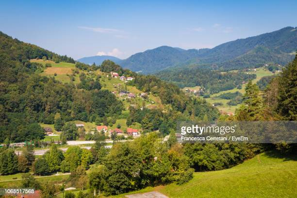 scenic view of townscape and mountains against sky - slowenien stock-fotos und bilder
