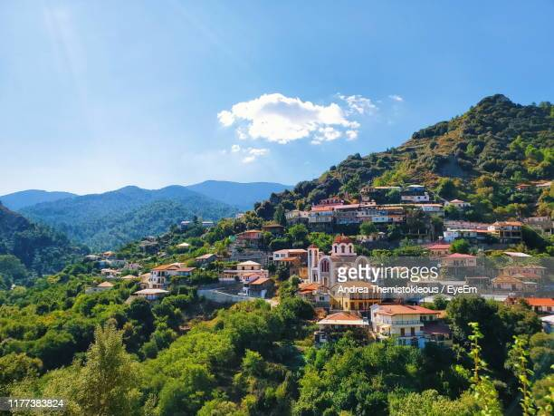 scenic view of townscape and mountains against sky - repubiek cyprus stockfoto's en -beelden