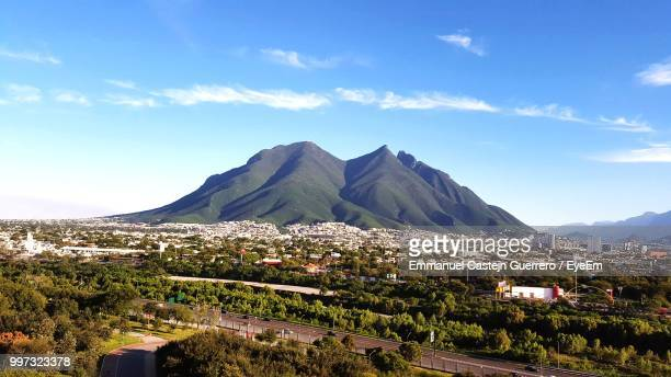 scenic view of townscape and mountains against sky - monterrey stock pictures, royalty-free photos & images