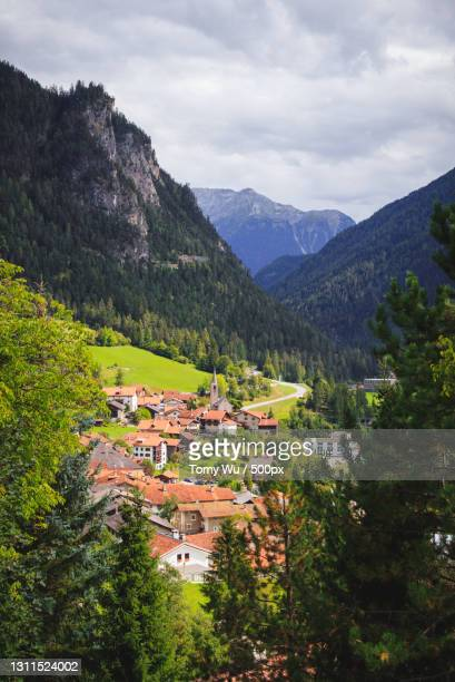 scenic view of townscape and mountains against sky,schweiz,switzerland - baum stock pictures, royalty-free photos & images