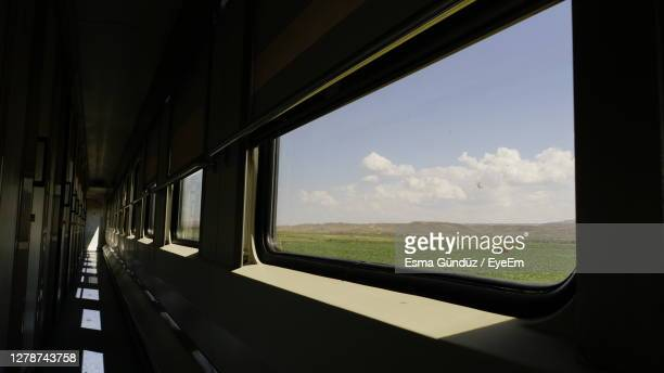 scenic view of train seen through window - carriage stock pictures, royalty-free photos & images