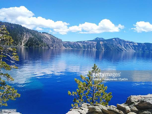 Scenic View Of Tranquil Lake Against Mountain Range