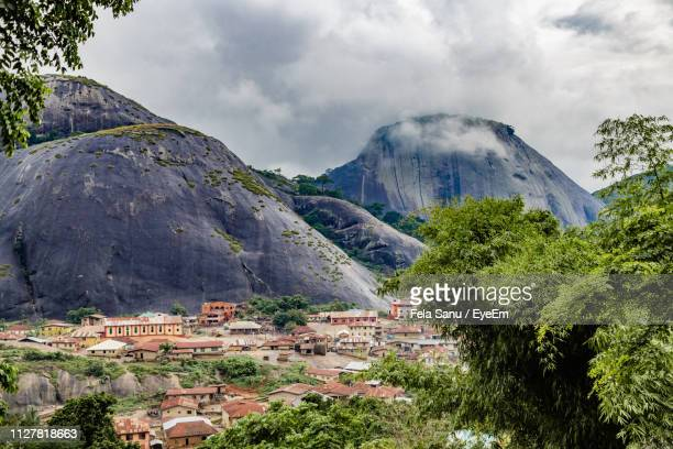 scenic view of trees and buildings against sky - nigeria stock pictures, royalty-free photos & images