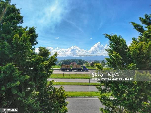 scenic view of trees and buildings against sky - japonês stock pictures, royalty-free photos & images