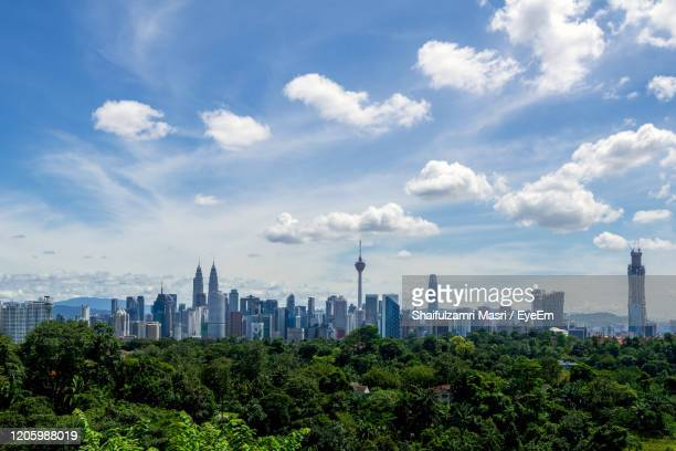 scenic view of trees and buildings against sky - shaifulzamri stock pictures, royalty-free photos & images