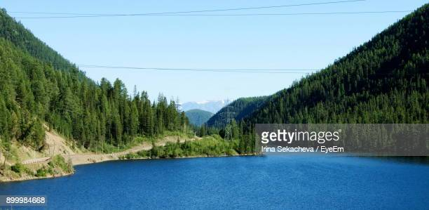Scenic View Of Trees And Mountains Against Clear Blue Sky