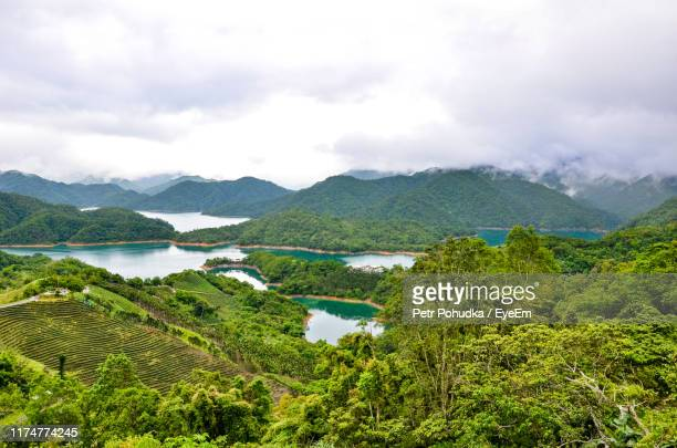 scenic view of trees and mountains against sky - taiwan stock pictures, royalty-free photos & images