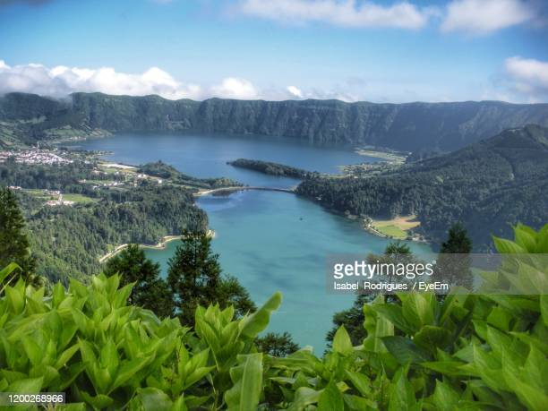 scenic view of trees and mountains against sky - las azores fotografías e imágenes de stock