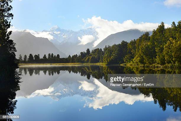 Scenic View Of Trees And Mountains Reflection In Lake Matheson