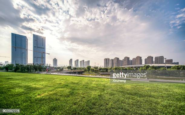 Scenic View Of Trees On Grassland At Park