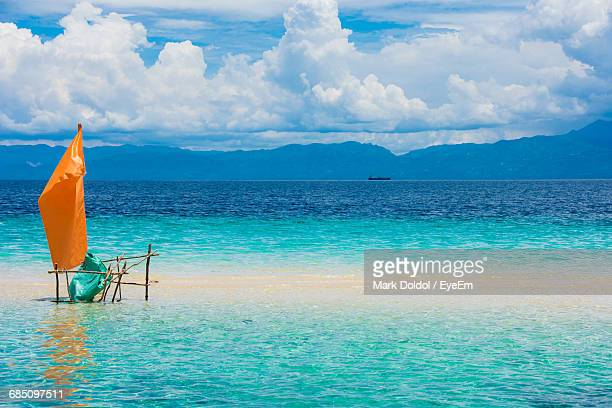 scenic view of turquoise colored sea against sky - cebu stock photos and pictures