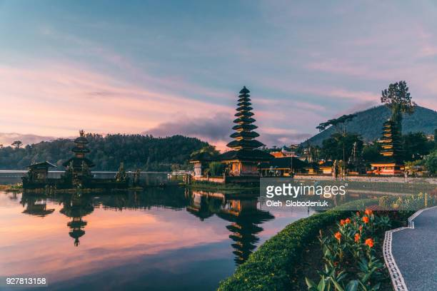 scenic view of ulun danu temple  in  bali  at sunrise - balinese culture stock pictures, royalty-free photos & images