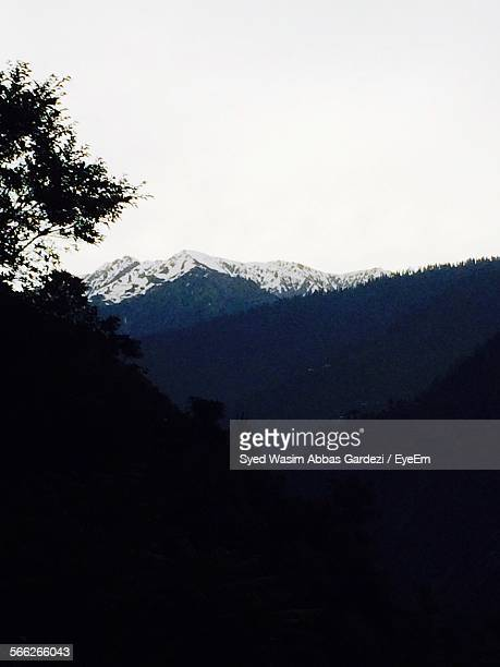 Scenic View Of Valley And Mountain Range Against Sky