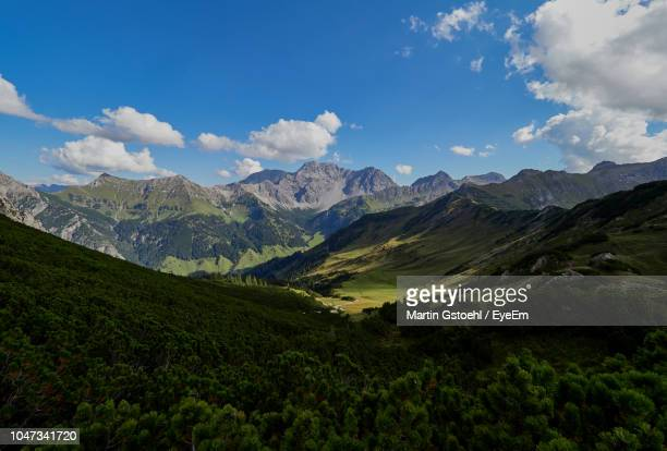 scenic view of valley and mountains against sky - principality of liechtenstein stock pictures, royalty-free photos & images