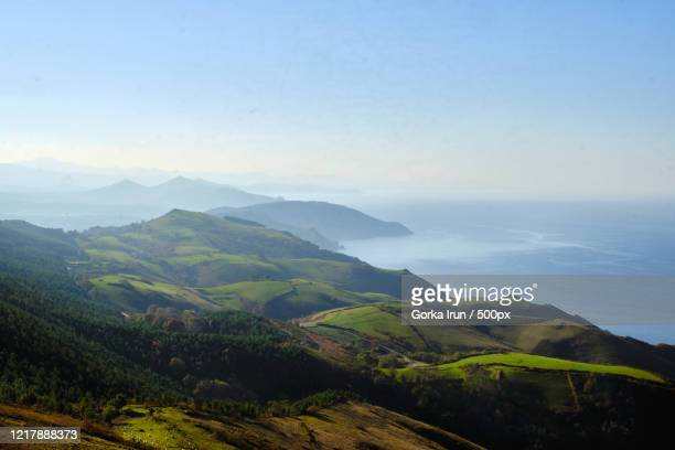 scenic view of valley with sea at dawn, hondarribia, gipuzkoa, spain - オンダリビア ストックフォトと画像