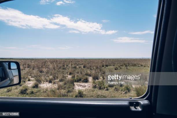 Scenic View Of Vast Prairie Through Car Window