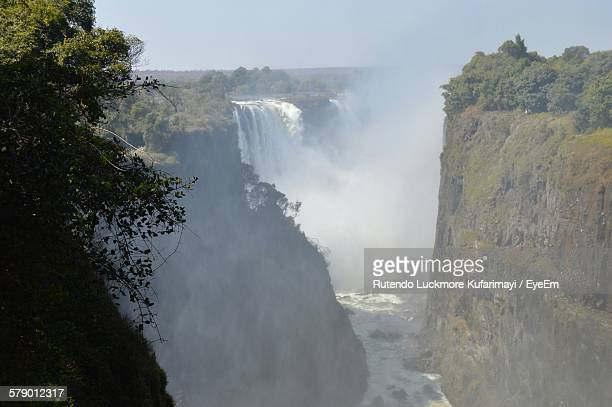 Scenic View Of Victoria Falls Amidst Mountain Valley