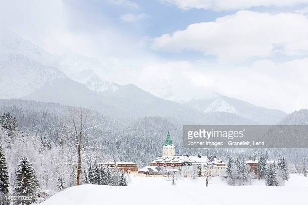 scenic view of village surrounded by mountains - garmisch partenkirchen stock pictures, royalty-free photos & images