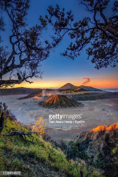 scenic view of volcanic crater against sky during sunset - tian abdul hanip stock photos and pictures