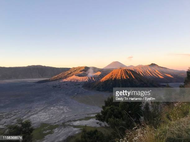 scenic view of volcanic landscape against sky during sunrise - bromo tengger semeru national park stock pictures, royalty-free photos & images