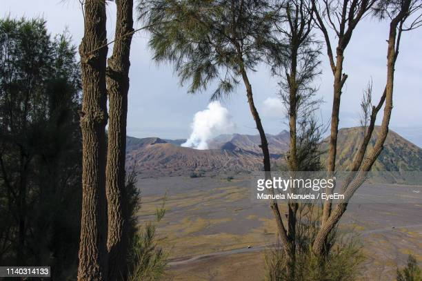 scenic view of volcanic landscape against sky - tengger stock pictures, royalty-free photos & images