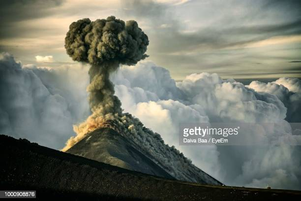 scenic view of volcanic mountain against sky - guatemala stock pictures, royalty-free photos & images