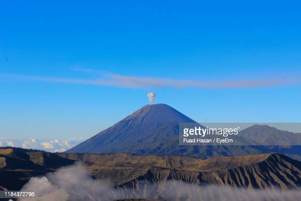 scenic view of volcano against blue sky - mt bromo stock pictures, royalty-free photos & images