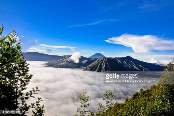 scenic view of volcano and mountains against sky - bromo tengger semeru national park stock pictures, royalty-free photos & images