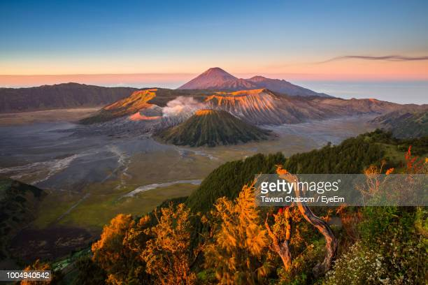 scenic view of volcano at bromo-tengger-semeru national park against sky during sunset - tengger stock pictures, royalty-free photos & images