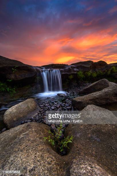 scenic view of waterfall against sky during sunset - makassar stock pictures, royalty-free photos & images