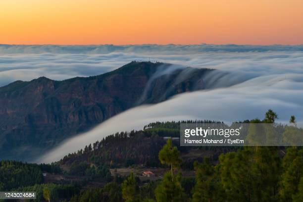 scenic view of waterfall against sky during sunset - tejeda canary islands stock pictures, royalty-free photos & images