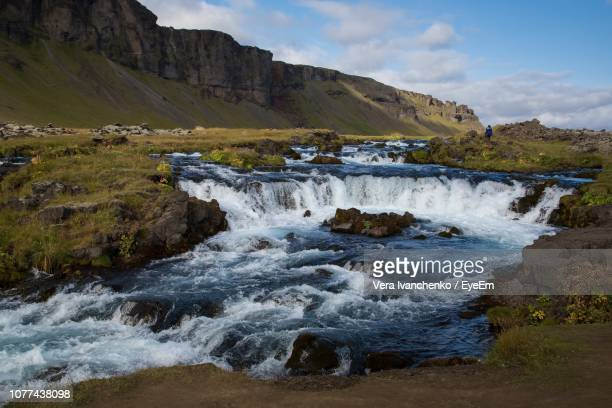 scenic view of waterfall against sky - mid distance stock pictures, royalty-free photos & images