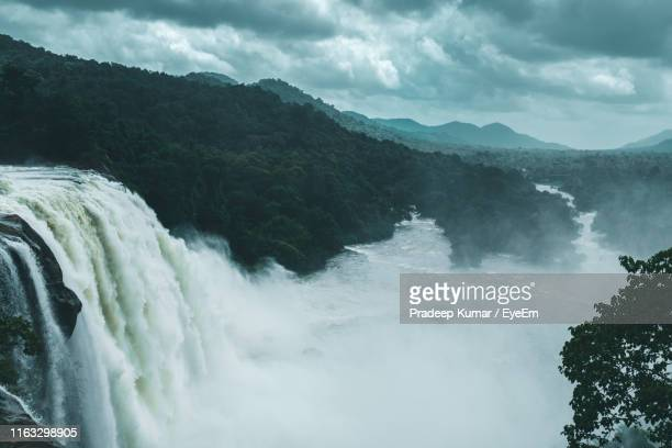 scenic view of waterfall against sky - kochi india stock pictures, royalty-free photos & images