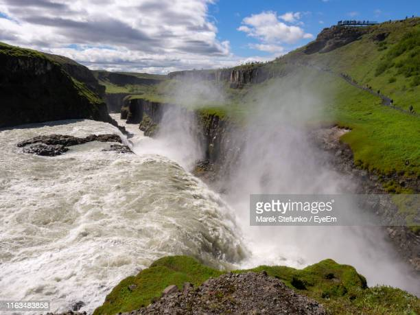 scenic view of waterfall against sky - marek stefunko imagens e fotografias de stock